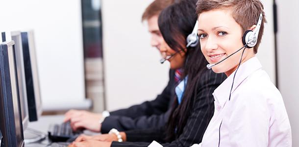 Careers service - Adviser at computer screen with headphones